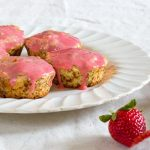 muffins with strawberries on white plate